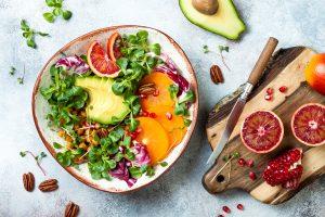 Vegan, detox Buddha bowl with turmeric roasted chickpeas, greens, avocado,